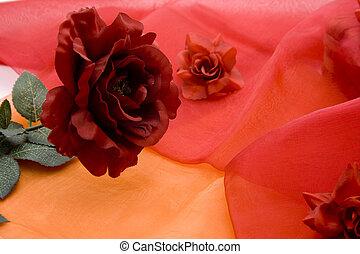 Red rose on silk cloth
