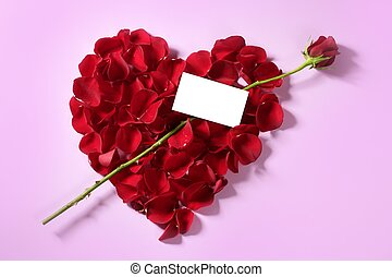 Red rose petals in heart shape, copy space blank note