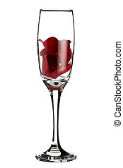 Red rose petals inside champagne glass