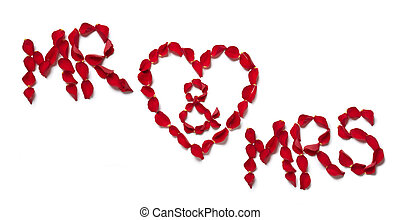 Red rose petals spelling mr and mrs on white background