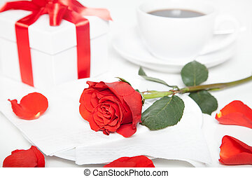red rose, present box and cup of coffee