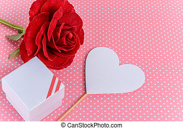 Red rose with valentines day card