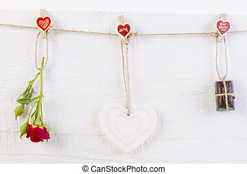 Red rose with white shape heart