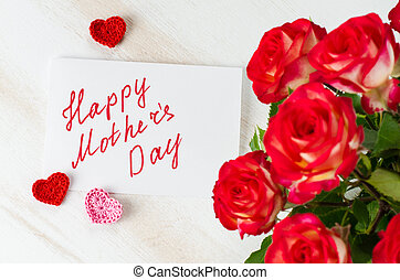 Red roses and card with text Happy Mothers Day