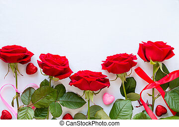 red roses and decorative hearts on white background for Valentine's Day