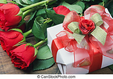 red roses and gift box for birthday, valentine