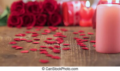 Red roses and gift box on wood
