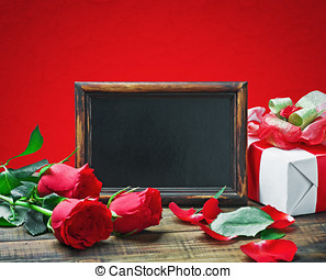 Red roses and gift for Valentine's Day or a birthday