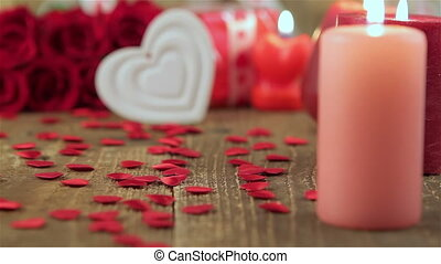 Red roses and heart shape on wood