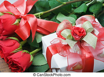 red roses and holiday gift
