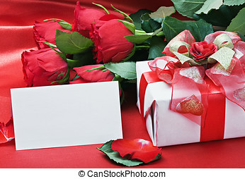 red roses and white card