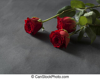 Red roses arrangement for a funeral grey