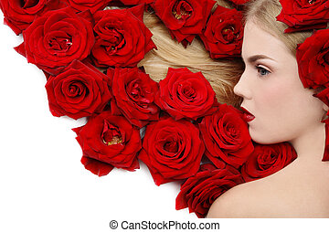 Red roses - Beautiful girl lying on white background with...
