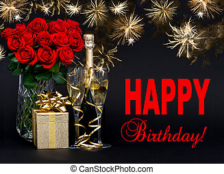 red roses, bottle of champagne, golden gift with beautiful firew