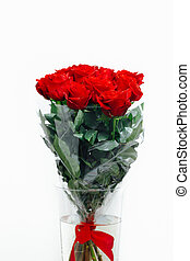 red roses bouquet in vase on white background, close-up view