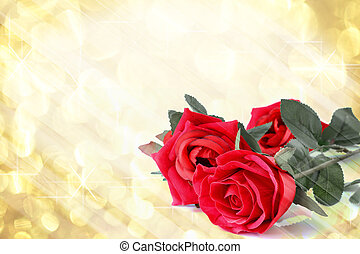 Red roses bouquet with gold light bokeh and free space for text valentine background.