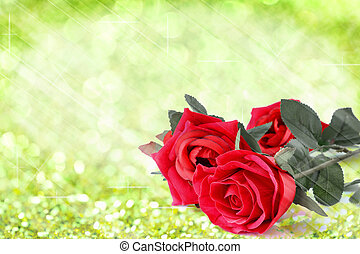Red roses bouquet with light green bokeh and free space for text twinkled bright background.
