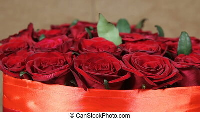 Red roses flowers bouquet in a box in form of a heart