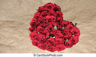 Red roses flowers bouquet in a box in the form of a heart