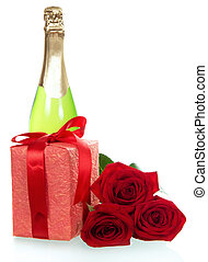 Red roses, gift and  bottle of champagne