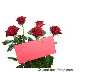 Red roses in a bouquet with a blank card