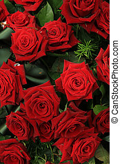 Red roses in bridal bouquet