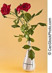 Red roses on a beige background