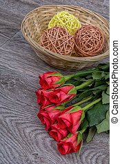 Red roses on a wooden background
