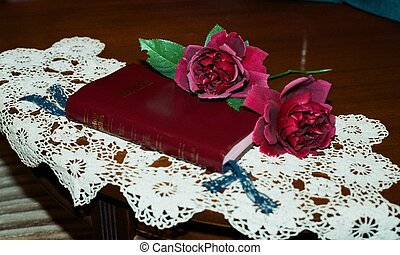 Red roses on the Bible
