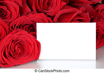 Red roses on Valentine's or mothers day with empty card and copy