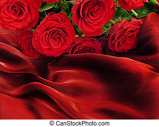 Red beautiful roses on a vinous silk fabric