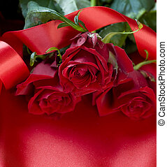 Red Roses over silk background