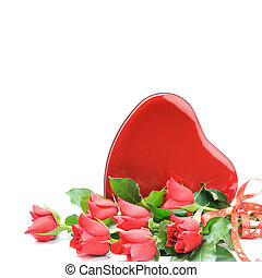 Red roses with heart shaped box of chocolate