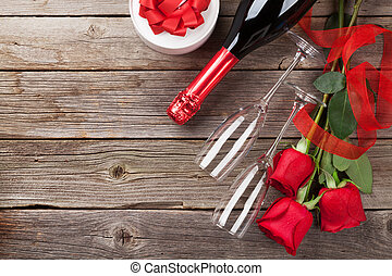 Red roses with Valentines day gift and champagne