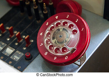Red Rotary Phone - Close up view of red and dirty rotary...
