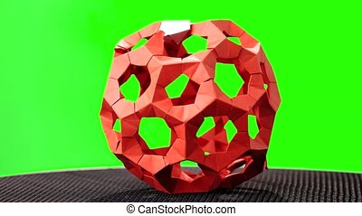 Red rotating modular origami. Green hromakey background for...