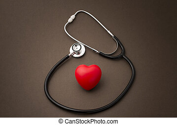 Red Rubber Heart with a Stethoscope on Brown Background