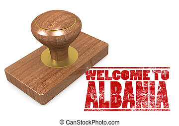 Red rubber stamp with welcome to Albania