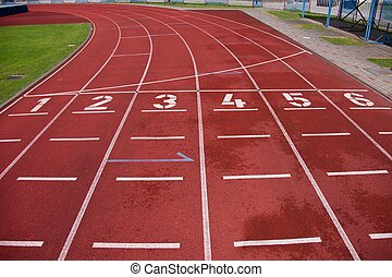 Red running racetrack on the athletic stadium