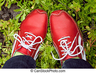 red running shoes on a grass