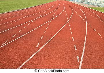 Red running track in stadium