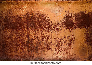 Textured pattern of red rust on a metal barrel