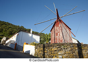 Red rusty windmill in Azores. Sao Jorge island. Portugal