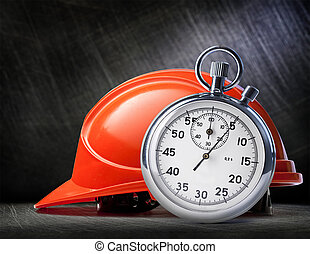 Red safety helmet on steel - Red safety helmet and stopwatch...