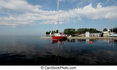 Sail boat - Red Sail boat at the pier in the background of...