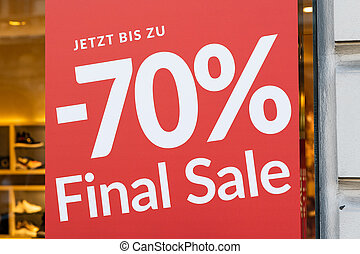 Red sale sign on a window of a shop