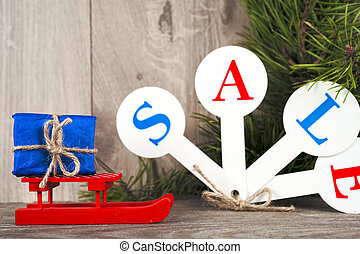 Red sale tags with inscription Sale on wooden background.