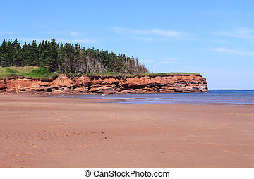 Red sand cliffs and beach at Cabot Beach, Prince Edward...