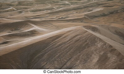 Red Sand Desert Dunes at Sunset - aerial of the red sand...