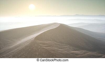 Red Sand Desert Dunes in Fog - aerial of the red sand desert...
